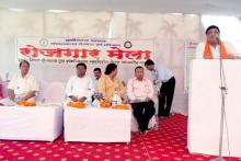 Guest giving speech at Rojgar mela